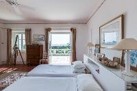 crisp and clean bedroom linens in Cannes Villa Boulevard des Collines luxury apartment