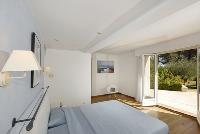 nice bedroom furnishings in Cannes Villa des Dauphins luxury apartment